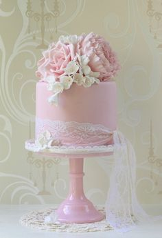 lose the lace, replace with design made from fondant or icing