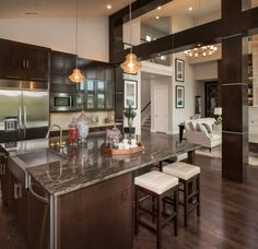 This modern and updated kitchen with top-of-the-line appliance + fixtures is sure to blow every guest away.