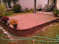 Patio On a Slope | block patio slope question - DoItYourself.com Community Forums Sloped Yard, Sloped Backyard, Backyard Playground, Backyard Patio, Retaining Wall Patio, Paved Patio, Patio Ideas On A Slope, Elevated Deck Ideas, Outdoor Steps