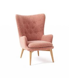 West Elm Niels Upholstered Wing  Inspired by Danish chair designs, this modern take on a midcentury chair is at once trendy and timeless in a shade of dusty pink.
