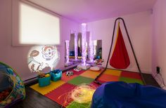 A therapeutic Snoezelen room is a multisensory environment designed to provide both relaxation and stimulation for kids with developmental challenges. It is filled with sights, sounds and movement. The Hanging Crow's Nest by Joki is a great place to relax in. Bubble tube, fiber-optic lights, projectors: TFH Special Needs Toys