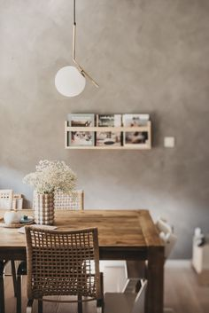Concrete-effect walls and webbed rattan dining chairs in this all-natural dining room