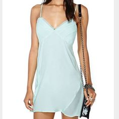 Nasty Gal Mona Slip Dress Mint Worn Once! Adorable Mona Slip Dress by Nasty Gal in Mint/Blue. This is sized XS, however I am not an extra small whatsoever. I would say it's a roomy small. I remember ordering a small in this dress and returning for the extra small. Nasty Gal Dresses Mini