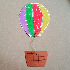 Up, up, & away! Floating in the skies is our colorful hot air balloon craft made here @ Alamitos library