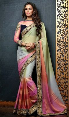 Flaunt your style in this gray, honeydew, pink and salmon embroidered chiffon sari. The appealing butta, lace and resham work a significant attribute of this attire. Upon request we can make round front/back neck and short 6 inches sleeves regular saree blouse also. #AwesomeDesignerSareeCollection