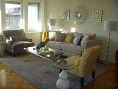 Whitney and Jon's new stylish living room looks cozy chic with our Pauline sofa, Pierre Chair, Bailey chevron chair, Cosmopolitan coffee table, Caprise Floor Lamps, Radiant Mirror, and Fretwork Mirrored Plaque.