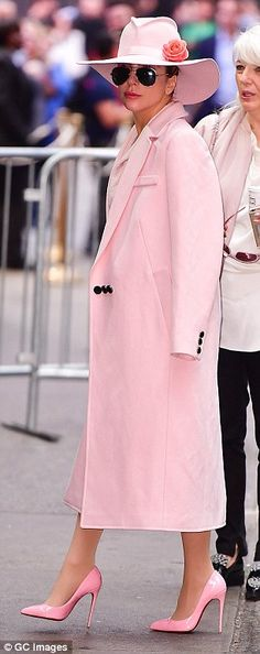 In the pink: The 30-year-old was fully co-ordinated in a rose wool coat, hat and shoes...