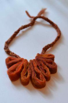 Account manager Mari turned Apple Creek Felt Pelt into a necklace!