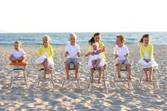 Beach shot: Love the yellow sweaters with the white dresses and the seersucker shorts for the boys.