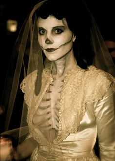 Skeleton Bride - VIntage Wedding Dress Holloween Costume ideas. Not sure why her dress needs to be open to her belly button...