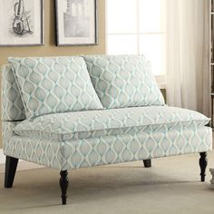Features:  -Modern styling with unique cream and aqua blue design print on fabric.  -Fully turned front legs in ebony finish.  -Web seat for lasting durability.  -Hardwood solid frame with generous pa