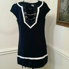 """HP bebe Black & White dress / tunic NWT bebe Black and white dress size small. I would say it would fit small just fine. It's a reposhed item and it just didn't fit me. It is a mini skirt/dress/ tunic in my opinion. From the shoulder to the bottom of the dress the total length is 30"""" No trade No paypal bebe Dresses"""