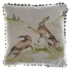 Boxing Hares is a fantastic linen blend cushion with a duo of boxing hares painterly effect design, fan edge trim and a wool windowpane check back