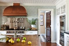 Nothing like a huge copper range hood against faint blue glass subway tiles....  Perfect marriage of color.