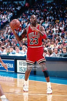 Michael Jordan #23 of the Chicago Bulls passes against the Sacramento Kings during a game played on November 14, 1989 at the Arco Arena in Sacramento, California.