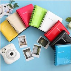 definitely want one of these cute little albums and a new instax camera!!