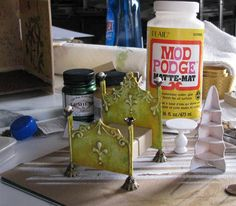 Great idea to use cardboard and dimensional paint for miniature furniture.