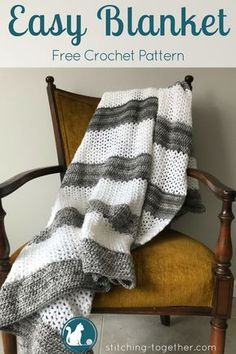 Easy and fun crochet throw free pattern! The gray and white stripes make this simple crochet blanket modern and beautiful. Wouldn't this blanket look great draped on your couch? Simple v-stitches and hdcs make this crochet throw free pattern easy yet engaging. #crochet #crochetthrow #crochetblanket #crochetafghan #crochetpattern #freecrochetpattern #freepattern #grayandwhite #diy #crafts