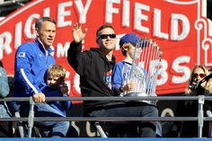 President of Baseball Operations for the Chicago Cubs Theo Epstein waves to the crowd during a World Series victory parade on November 4, 2016 in Chicago, Illinois.  The Cubs won their first World Series championship in 108 years after defeating the Cleveland Indians 8-7 in Game 7.