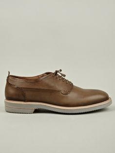 The Alexander McQueen Men's Minnesota Leather Saddle Shoe.    Produced in a singular colour, Alexander McQueen's version of a saddle shoe is a modern re-working of the traditional design, and is built on a lightweight Vibram sole, making it ideal for the warm summer months.    The uppers are crafted from smooth premium leather that is wonderfully supple, and are fully lined for comfort. The shoes also feature a pinked edge on the heel panel, white waxed laces and a pull tab on the heel.