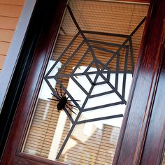 Easy Webbed Window Covering for Halloween!