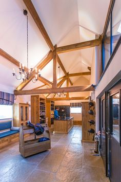 tack room with vaulted ceilings and beams