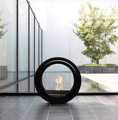Roll Fire by Conmoto: Beautiful bio-ethanol fireplace which rolls to where you need warmth, the stainless steel tank balanced on roller bearings with fitted glass sides held in place with magnets. Wall bracket available.