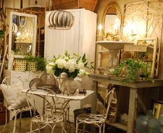love the table and chairs..    cool industrial light, soft colors, pretty