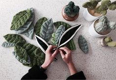 faux foliage, a big trend we're seeing continue really strong this year. From knitted cacti and succulents from artists such as Andrea Daniel of Odds and Ends Handmade