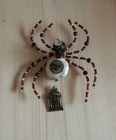 Quirky handmade beaded spider brooch with added charms