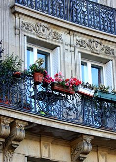 This was my favorite part about France.Balcony on the Champs Elysees, Paris. I want an apartment with a black iron balcony!