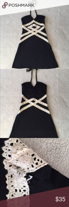 Black and white Guess halter dress Black and white/cream Guess halter dress. Gently used in good condition. No trades. Small tear in lace as pictured. Please ask all questions and use the offer button, thanks! Guess Dresses
