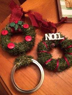 Mason jar lid wreaths! I used pine pipe cleaners and buttons. Super simple…