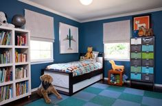 Bold blue on the walls gives the room a cozy ambiance