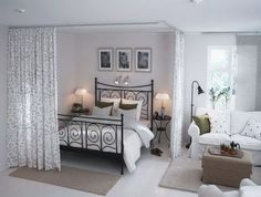 love the curtains to separate the bedroom space