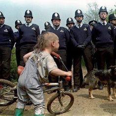 From book project, WOOFERS: Dogs & Their People. A child and his dogs inspect a line of police officers as they prepare to serve an eviction order on an illegal encampment of new age travellers in rural Warwickshire, England, UK in Bane Of My Life, Winter's Tale, Great Pic, Book Projects, Something Beautiful, New Age, Police Officer, Good People, Crow