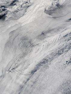 Early November 2015 brought cloudy skies and intriguing patterns over the Prince Edward Islands in the South Indian Ocean. The Moderate Resolution Imaging Spectroradiometer (MODIS) aboard NASA's Terra satellite captured this scene on November 5.