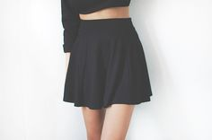 Black monochromatic outfit. Black high waisted skirt, paired with black long sleeved crop top.
