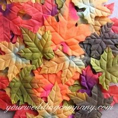 Place colorful silk fall leaves on tabletops or have your flower girl sprinkle them as she walks down the aisle.  Use in wedding favors and centerpieces. www.yourweddingcompany.com