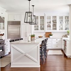 Luxury Kitchen white kitchen, kitchen island, kitchen island lights, glass cabinets in kitchen Kitchen Island Decor, Kitchen Cabinets Decor, Kitchen Island Lighting, Cabinet Decor, Kitchen Fixtures, Kitchen Stools, Best Kitchen Designs, Kitchen On A Budget, Kitchen Cost