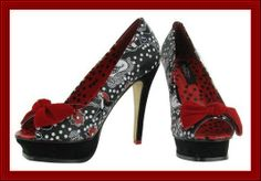 Birds of a Feather Iron Fist stiletto high heeled women's peep toe shoes offer retro style white polka dots, birds and flower pattern. They have a black platform and heel and red velvet bow on the toe.