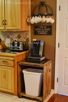 Set up a coffee station above a trash can cabinet made with wooden pallets. #coffeecups