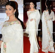 Aishwarya Rai: Latest Saree Blouse Designs sure to Amaze You'. In Pic: OMG in Broad Boat Neck Blouse In Lace With Uncut Edges, w/ floral Tarun Tahiliani saree; earrings gorg too (in Indian Saree Fashion @ via White Saree Blouse, Lace Saree, Saree Dress, Wrap Blouse, Indian Dresses, Indian Outfits, Indian Attire, Indian Wear, White Saree Wedding