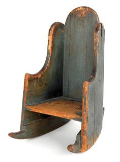 """New England painted pine child's settleback rocking chair, ca. 1760, with original blue painted surface and rose head nail construction, 24"""" h., 12"""" w. Provenance: Brian Windsor, Staten Island, New York."""