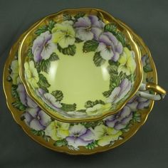Vintage Paragon Yellow, Gold and Puprle Pansy English Bone China Teacup and Saucer. $85.00, via Etsy.