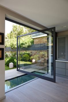 A pivot door and a walk on glass rooflight