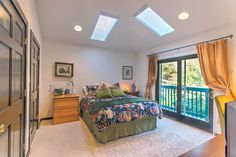 The guest suite -- queen bed, vaulted ceiling with skylights and a small private deck. Very private.