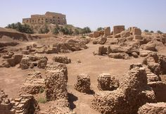 The ruins of the ancient city Babylon with one of Saddam's palaces in the background.