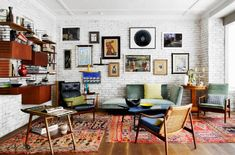 Exposed painted brick wall, colour, hanging shelves, midcentury furniture