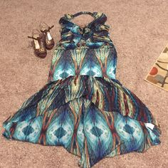 sexy boho chic hi-lo dress  NWOT ‼️ one of a kind‼️ turn heads in this Gorgeous tribal influenced hi-lo dress. Halter top. Feather accent. Mermaid fit. Runs small. Baby Phat Dresses High Low